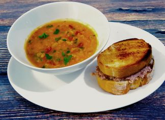 Picture of a healthy lunch which includes a bowl of spicy chorizo and lentil soup with a crunchy tuna toastie on the side