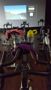 Picture from the view of behind a spin bike prior to the start of a spin class starting