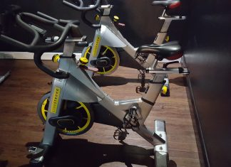 Picture of a spin bike in a gym class environment
