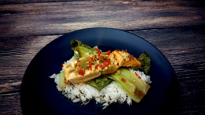Thai salmon served on a bed of basmati rice and bok choy.